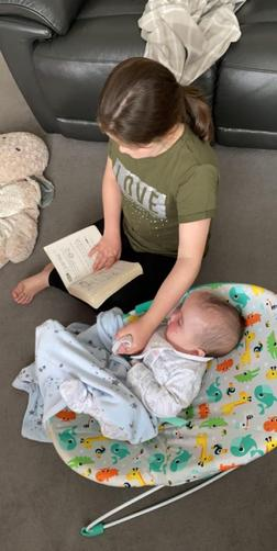 Maci reading to her brother!