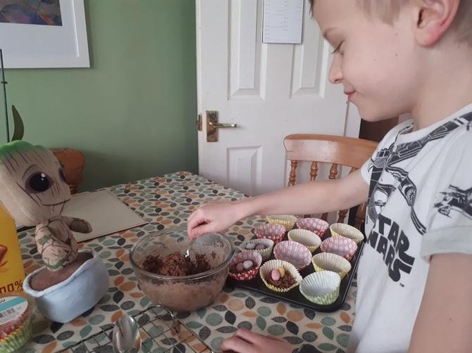 Oliver and mascot Groot baking Easter goodies!
