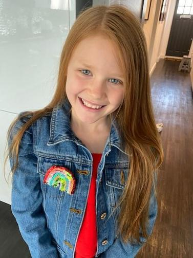 Faye's handmade rainbow badge
