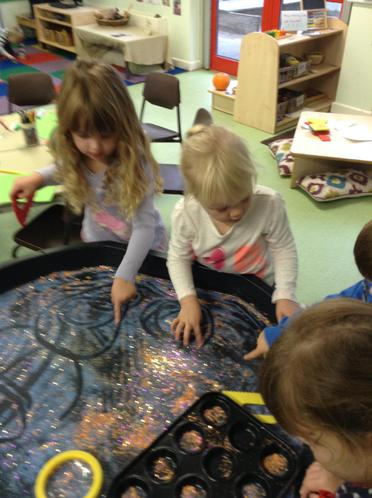 We drew patterns in sparkles and sand.