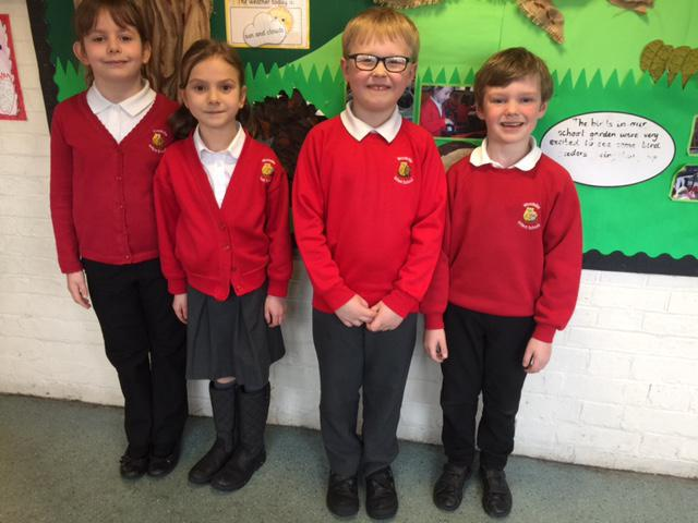 Look at us in our smart red school uniform.