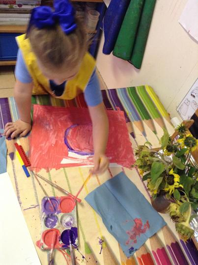 Painting with pink and purple paint.