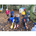 Working together - raking up the leaves!