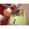 Making a fruit kebab
