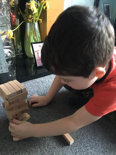 H enjoying a game of Jenga