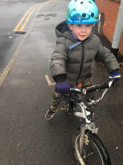 H enjoying a soggy bike ride