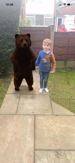 A met one of the 3 bears in his garden!
