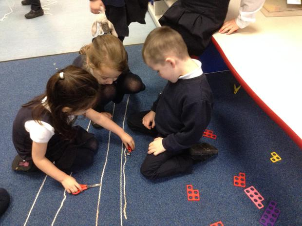 Working together - Measuring using wool.