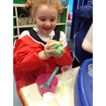 Mixing ingredients to make slime.