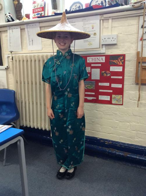Proudly wearing her mum's Chinese outfit