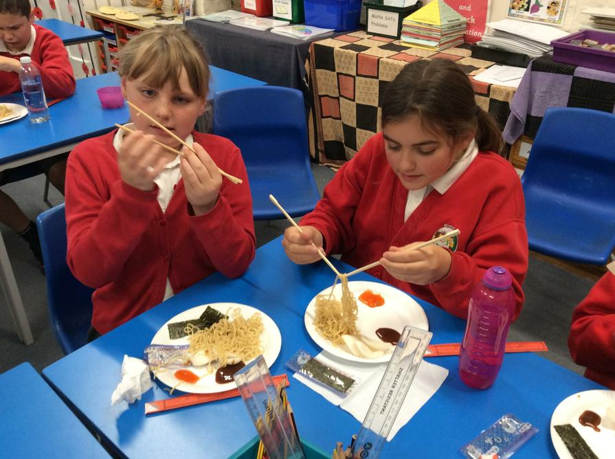We learnt how to eat with chopsticks