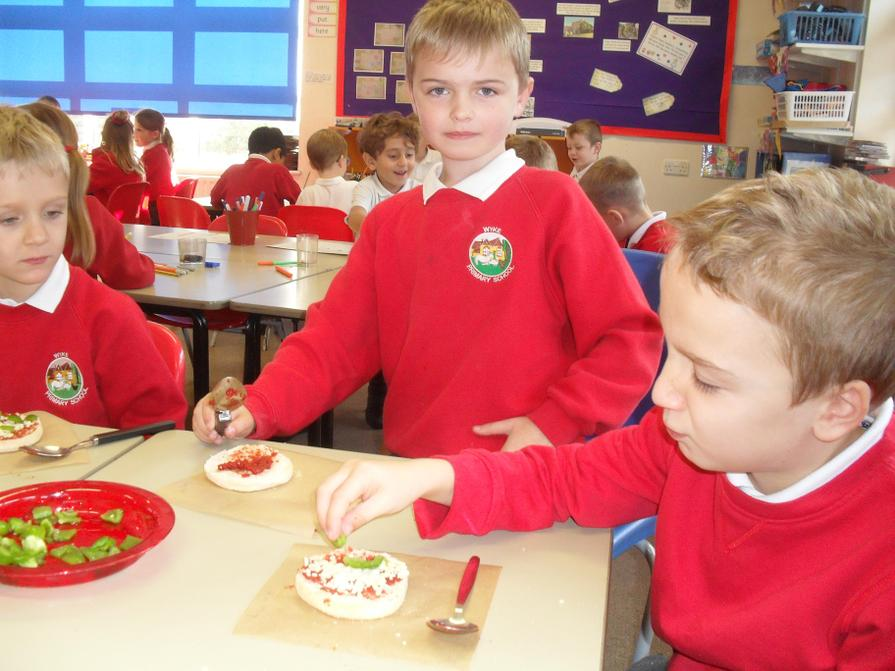 We tasted different vegetables and made pizzas.