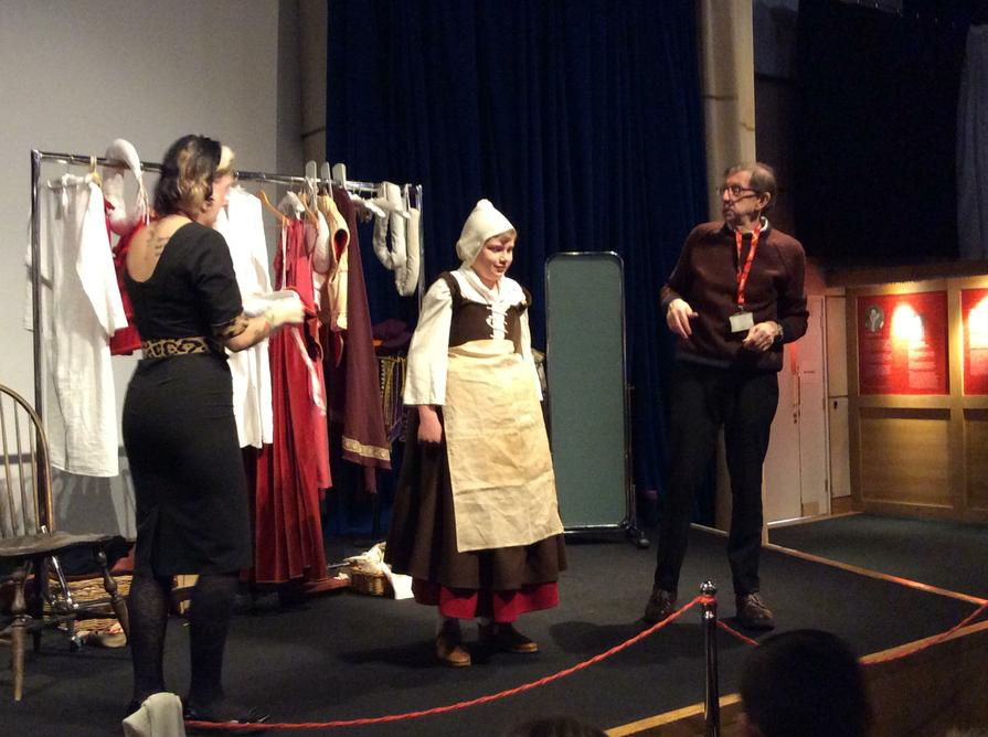 An apron and bonnet finshed the costume