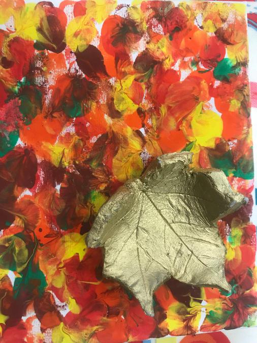 We created clay leaves and a seasonal backdrop