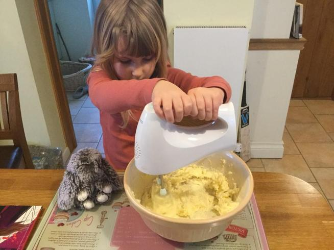 Helping to make her birthday cake