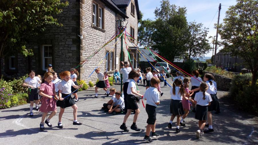 Maypole dancing at Granby House