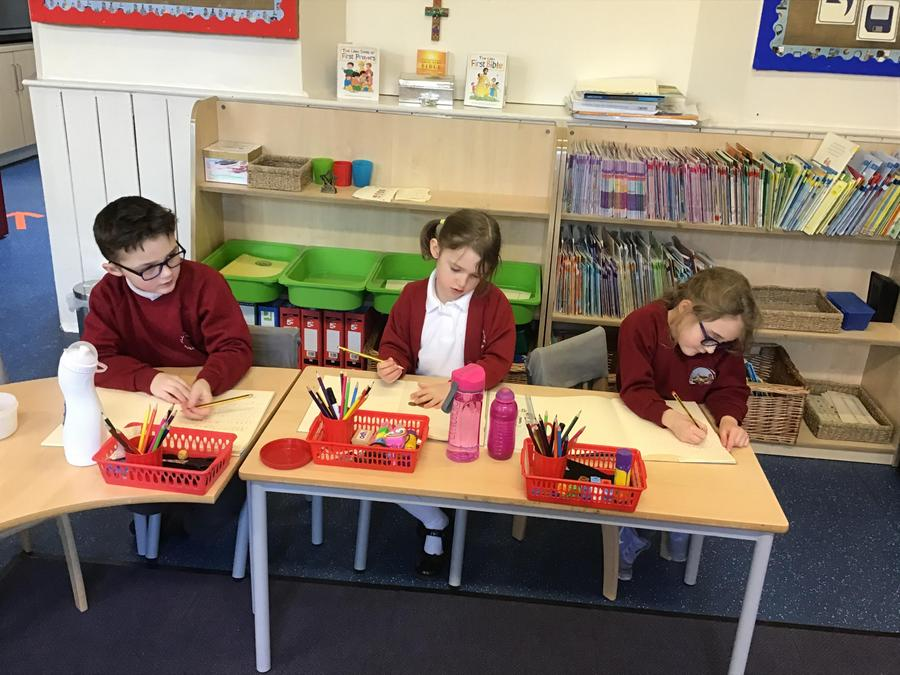 Year 2's working hard with their English.