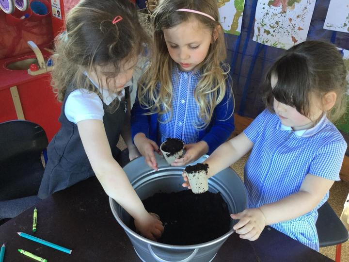 Filling our containers with compost
