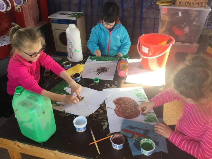 Creating mud paintings using natural materials