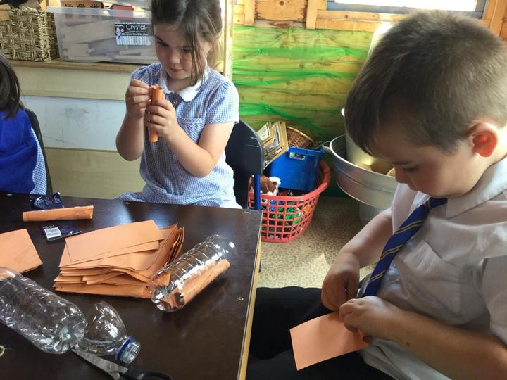 We used recycled bottles, paper and string