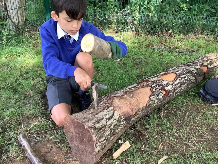Using the knife to help split the wood