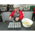 e-Cafe Year 6 Cafe worker making Fairtrade cakes