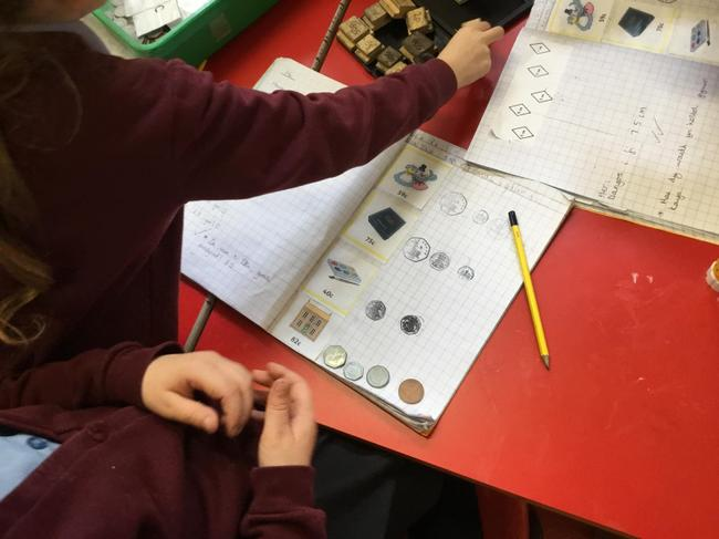 Paying for items in Class 4's shop!