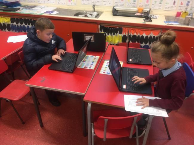 Pupils completing the application form on HWB.