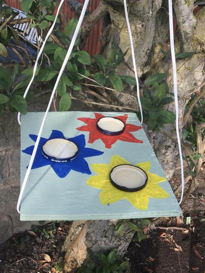 A butterfly feeder made from recycled materials.