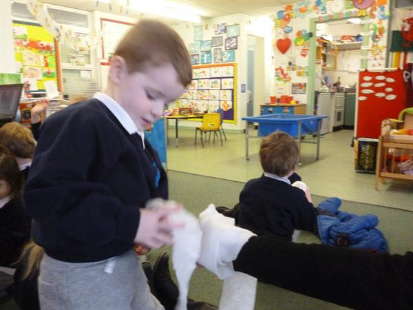 The children bandaged up each other.