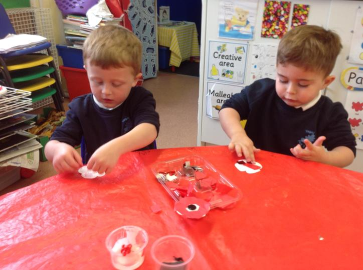 sticking black and red on our poppies