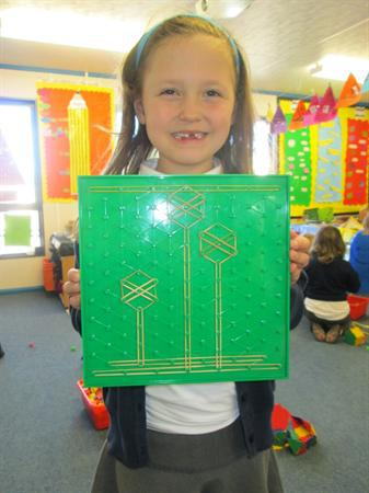 Izzy has made a garden picture using geo boards
