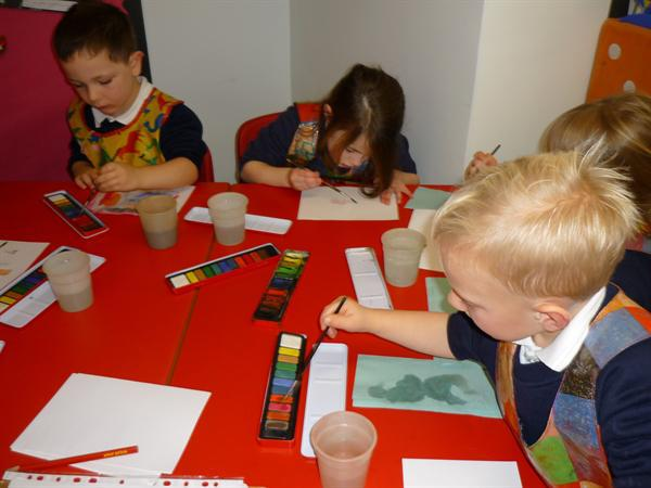 Using watercolours to make a fishy picture.