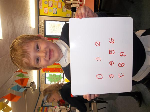 Finley has been practising writing his numbers!