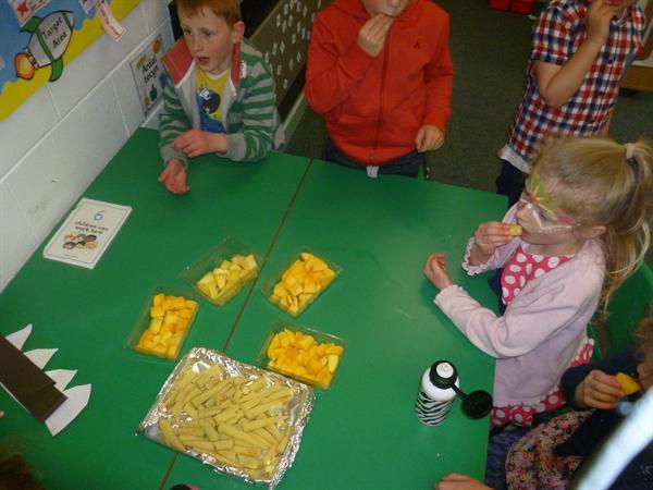 Food tasting- pinpeapple, corn and mango.