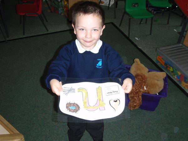 Using playdough to practise letter formation.