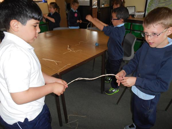 Working together to make woven bracelets