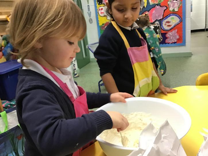 Making biscuits for 'diwrnod Santes Dwynwen'.