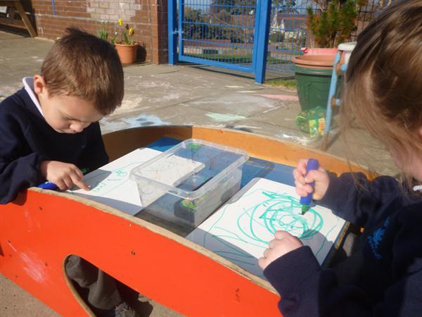 Enjoying mark-making outdoors