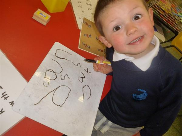 Writing sounds and beginning simple cvc words.