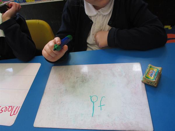 Practising writing our sounds.
