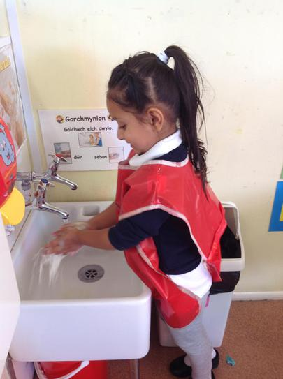 washing our hands well with soap after painting