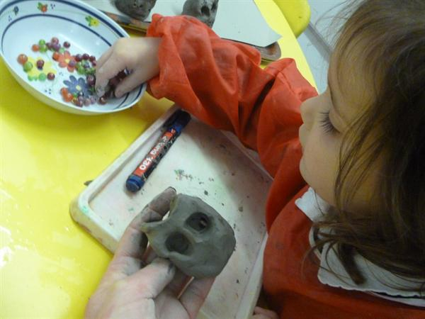 Making owl sculptures using clay.