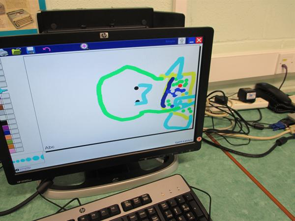 Using the computer to draw the rainbow fish.