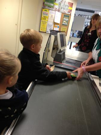 Paying for our items and waiting for our change