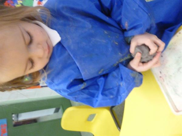 Making an owl using clay.