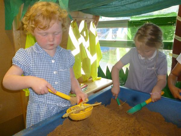 Busy in the Dino Dig role play area