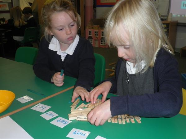 using pegs with sounds on to make words