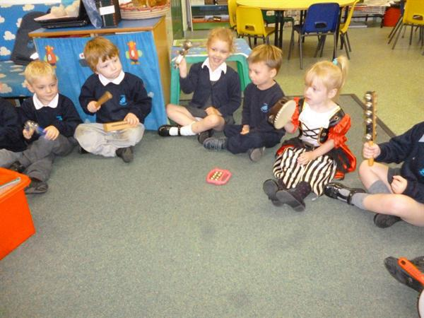 Using the percussion instruments.