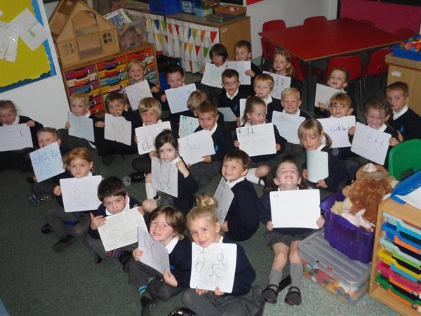 Letter formation using our whiteboards.